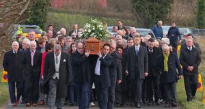 The coffin of Seamus Mallon is carried to Saint James of Jerusalem Church in Mullaghbrack, Co Armagh. Photograph: Liam McBurney/PA Wire