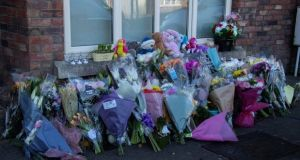 Flowers are seen outside the McGinley family's home in Newcastle, Co Dublin on Monday. Photograph: Colin Keegan/Collins.