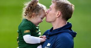 James McClean with his daughter Willow at the unveiling of Aviva's new Sensory Hub. The initiative aims to make the Aviva Stadium a more inclusive space for people with additional sensory needs. The state-of-the-art sensory booth is free for any fan to use. Photograph: Sportsfile