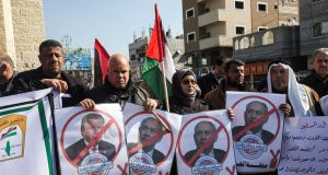 Palestinian demonstrators chant slogans while holding portraits of US president Donald Trump and Israeli prime minister Binyamin Netanyahu,in Rafah in the southern Gaza strip on Tuesday.  Photograph:  Said Khatib/AFP via Getty Images