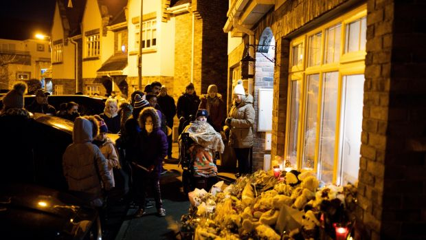 Vigil for Conor, Darragh and Carla McGinley on Wednesday night at their home in Parson's Court, Newcastle, Co Dublin. Photograph: Tom Honan