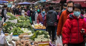 People wearing masks visit a fresh food market in Hong Kong  as a preventative measure after a virus outbreak which began in the Chinese city of Wuhan. Photograph: AFP