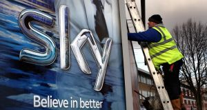 File photo of a worker erecting a Sky TV poster in the UK. Photograph: David Jones/PA Wire
