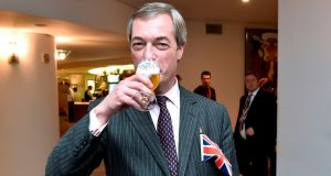 Britain's Brexit Party leader Nigel Farage drinks a beer on the sidelines of a European Parliament plenary session in Brussels on Thursday. Photograph: John Thys/ AFP/Getty Images