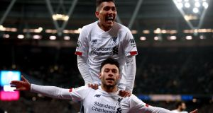 Liverpool's Alex Oxlade-Chamberlain celebrates scoring his side's second goal of the game with team-mate Roberto Firmino during the Premier League match against West Ham at London Stadium.  Photograph: Adam Davy/PA Wire