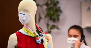 Coronavirus threat: A Bangkok mannequin models a face mask designed to protect against infection. Photograph: Mladen Antonov / AFP.