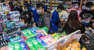 People leaving a pharmacy in Hong Kong after buying surgical masks as a preventative measure against the virus outbreak. Photograph: AFP via Getty