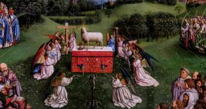 Central tableau of the 15th-century Ghent Altarpiece by Van Eyck  –  a panel known as the Adoration of the Mystic Lamb – after  a three-year restoration. Photograph: Dirk Waem/Belga /AFP via Getty