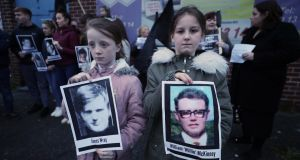 Two children hold pictures of Bloody Sunday victims James Wray and William McKinney during a vigil in west Belfast in March 2019. Photograph: Niall Carson/PA Wire