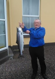 Local angler Kevin O'Shea with first salmon of 2020 in Ireland, caught in Butler's Pool, Waterville, Co Kerry. Photograph: Vincent Appelby