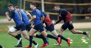 Ollie Devoto (L) sprints away from team mates during England training in Portugoal. Photograph: David Rogers/Getty