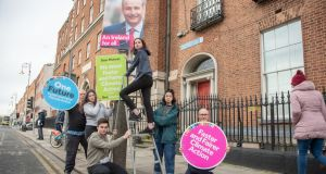 School climate strikers deliver key election demands: Conor Slattery (17), Réiltín Courtney (14), Mya Farrell on ladder (13) and Chaya Smyth (14). They are with Kevin Farrell and Oisin Coghlan.