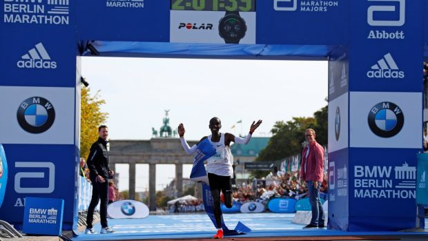 Kenya's Eliud Kipchoge celebrates as he wins the Berlin Marathon and breaks the World Record wearing Nike Vaporfly shoes. Photograph: Fabrizio Bensch/Reuters