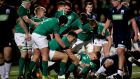 Ireland celebrate Jack Crowley's opening try against Scotland. Photograph: James Crombie/Inpho