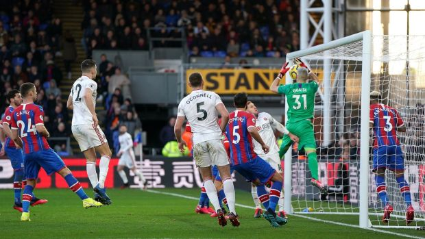 Crystal Palace goalkeeper Vicente Guaita scores an own goal at Selhurst Park. Photo: Tess Derry/PA Wire.