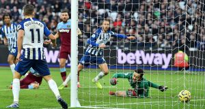 Brighton's Glenn Murray scores his team's third goal against West Ham. Photo: Glyn Kirk/Getty Images
