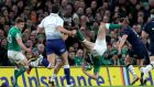 Ireland's Jacob Stockdale is upended. Photo: James Crombie/Inpho