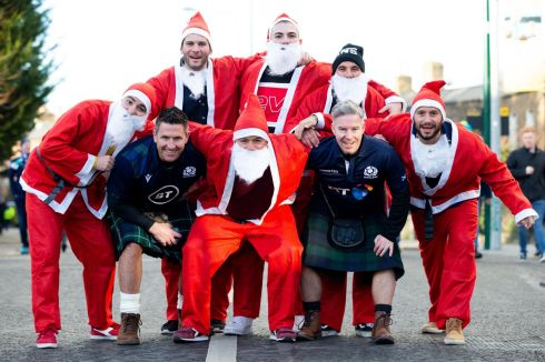 Scotland fans Scott McKechan and Alan McLardie are joined by Italian rugby fans dressed as Santa. Photo: Tom Honan/The Irish Times.
