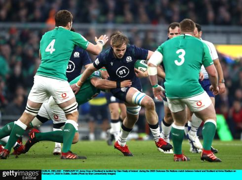 Jonny Gray of Scotland is tackled by Cian Healy of Ireland. Photo: Bryn Lennon/Getty Images