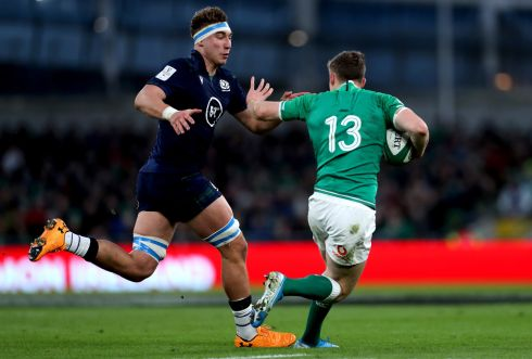 Scotland's Jamie Ritchie closes down Garry Ringrose. Photo: James Crombie/Inpho