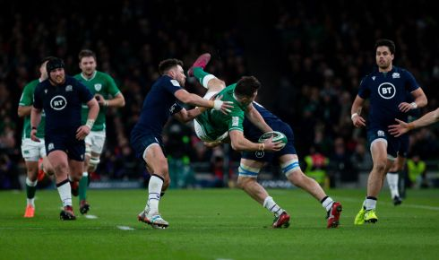Ireland's Jacob Stockdale us upended by Scotland's Ali Price and Nick Haining. Photo: Tom Honan/The Irish Times.