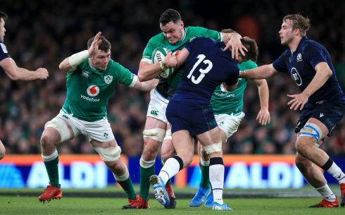 Ireland's James Ryan is tackled by Huw Jones of Scotland. Photo: Gary Carr/Inpho