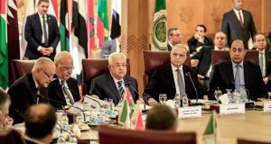 Palestinian president Mahmoud Abbas (3rd left) and Palestine Liberation Organisation  secretary-general Saeb Erekat (2nd left) look on as Arab League secretary-general Ahmed Aboul Gheit (left) reads a statement during an Arab League emergency meeting, at the league headquarters in Cairo, Egypt. Photograph: Khaled Dersouki/AFP via Getty Images