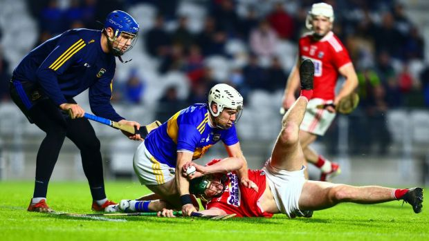 Tipperary's Seán O'Brien concedes a penalty by fouling Cork's Robbie O'Flynn. Photo: Ken Sutton/Inpho