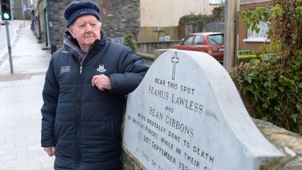 Jimmy Lawless, grandson of Séamus Lawless who was murdered by the Black and Tans in January 1920, at the spot he was killed on Bridge Street, Balbriggan. Photograph: Dara Mac Dónaill/The Irish Times