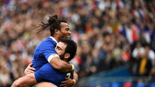 Teddy Thomas and Charles Ollivon celebrate after the France captain scored his side's second try at the Stade de France. Photograph: Franck Fife/Getty/AFP