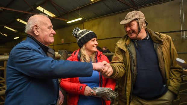 Cllr Sarah O'Reilly of Aontú canvassing at Clones mart, Co Monaghan, with Jim Duffy from Monaghan and Donal Keappock from Cootehill, Co Cavan. Photograph: Philip Fitzpatrick