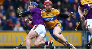 Wexford's Kevin Foley is challenged byClare's John Conlon during the Allianz Hurling League Division 1B game at  Chadwicks Wexford Park. Photograph:  Tom O'Hanlon/Inpho