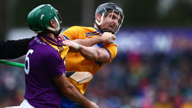 Wexford's Shaun Murphy and Clare's Tony Kelly scuffle during the game. Photograph: Tom O'Hanlon/Inpho