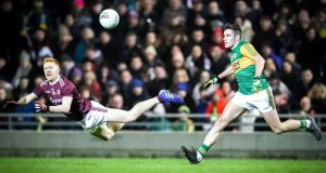 Adrian Varley of Galway and Graham O'Sullivan of Kerry. Photograph: Keith Wiseman/Inpho