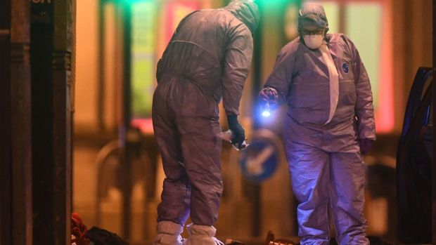 Police forensic officers work at the scene of a terror attack in Streatham High Road, south London after a man was shot dead by armed officers on Sunday. Photograph: Victoria Jones/PA Wire