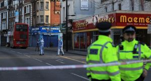 Forensic officers at the scene on Monday of the terror attack on Streatham High Road in th London. Photograph: Aaron Chown/PA Wire