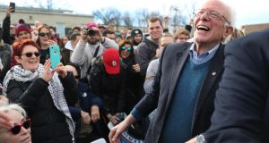 Democratic presidential candidate Bernie Sanders greets people during a stop at a campaign field office in Cedar Rapids, Iowa on Sunday. Photograph:  Joe Raedle/Getty Images