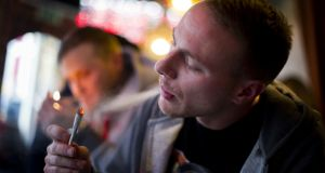 Smoking cannabis in a coffee shop in Amsterdam. Photograph: Jasper Juinen/Getty