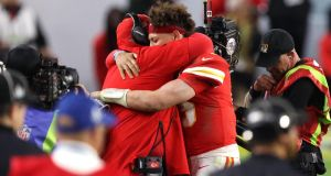 Patrick Mahomes hugs head coach Andy Reid after the Kansas City Chiefs' Super Bowl victory. Photograph: Al Bello/Getty