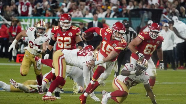 Patrick Mahomes runs the ball during Super Bowl LIV between the Kansas City Chiefs and the San Francisco 49ers. Photograph: Timothy A Clary/Getty/AFP
