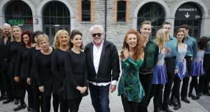Riverdance troupe members past and present with John McColgan, centre, outside 3Arena. Riverdance: 25th Anniversary Show will play the Dublin venue  February 6th-9th. Photograph: Nick Bradshaw