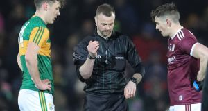 Kerry captain David Clifford,  referee Anthony Nolan and Galway captain Shane Walsh before their League match in Tralee. Photograph: Keith Wiseman/Inpho