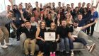The team at Asana with their Great Place to Work award for Recognising Team Achievement.