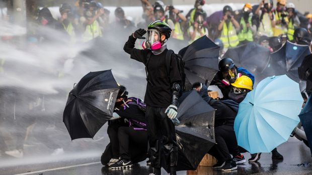 Police fire water cannons at pro-democracy protesters outside the government headquarters in Hong Kong on September 15th, 2019. Photograph: Isaac Lawrence/AFP/Getty Images