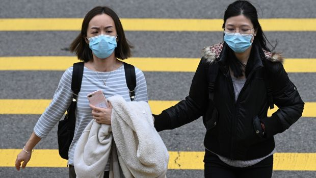 'Nobody has seen this virus before. So everyone is susceptible.' Above, two women in Hong Kong. Photograph: Anthony Wallace/AFP via Getty