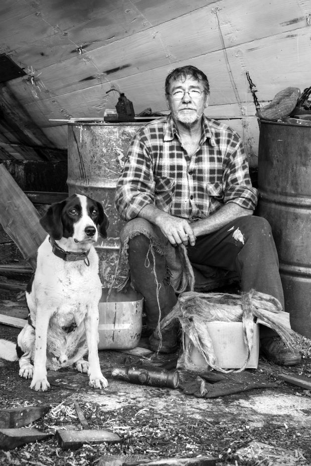 Fachtna O'Sullivan and Jasper at Hegarty's Boatyard. Photograph: Kevin O'Farrell