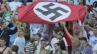 Supporters of Karpaty Lviv hold a Nazi flag at a soccer match against Dynamo Kiev in Kiev in 2007. Photograph: Reuters