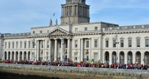 The childcare march passing the Custom House in Dublin. Photograph: Alan Betson / The Irish Times