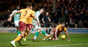 Celtic's Leigh Griffiths scores his side's second goal  during the  Scottish Premiership match against Motherwell at Fir Park Stadium. Photograph:  Steve Welsh/PA Wire