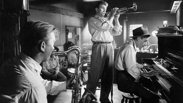 Hoagy Carmichael playing piano and Kirk Douglas playing trumpet in a scene from the 1950 film Young Man with a Horn, directed by Michael Curtiz